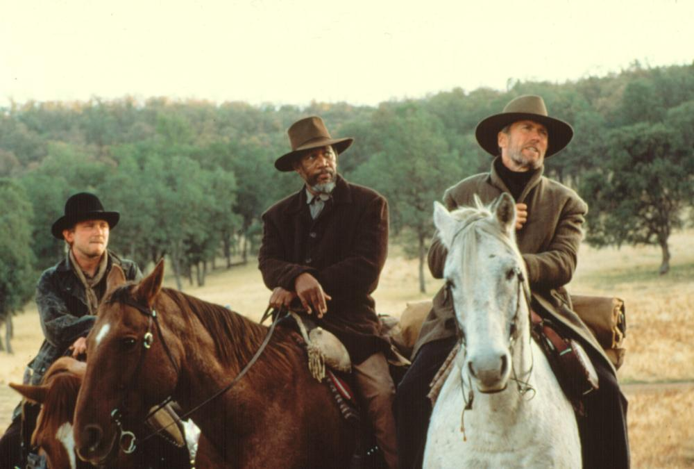 UNFORGIVEN, Jaimz Woolvett, Morgan Freeman, Clint Eastwood, 1992
